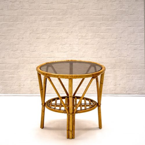 Small round cane table for rental in wanaka